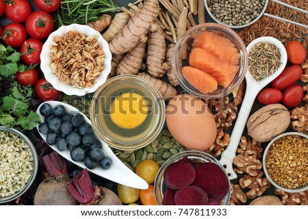 Food to promote brain power and memory concept with nuts, seeds, herbs, vegetables, fruit, dairy and fish. Super foods high in vitamins, antioxidants, omega 3 fatty acids, anthocyanins. Top view.