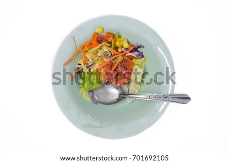 Food waste left over.Food scraps in the dish on white background.Not cleaning the plate.The dirty dish.Empty and dirty plate, with leftovers, isolated on white background ストックフォト ©