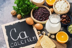 Food with calcium. A variety of foods rich in calcium. Signboard with the word-calcium. Top view