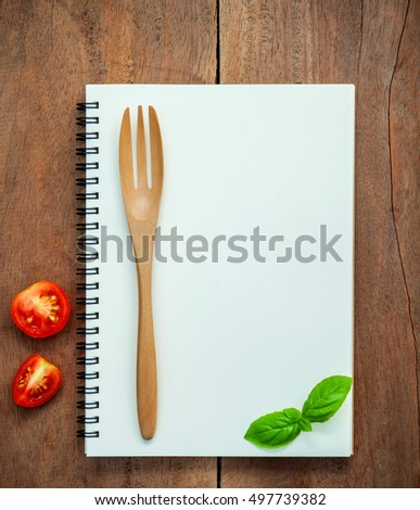 Foods background and Food menu design sweet basil and cherry tomatoes sliced  setup with notebook on dark shabby wooden table. Foods stylist vegetables and utensils on wooden background with flat lay. #497739382