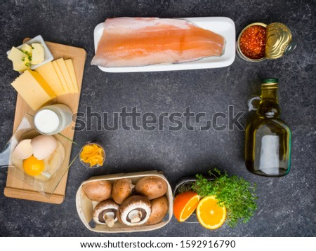 Foods containing vitamin D: fish, caviar, orange, micro greens, cheese, eggs, mushrooms milk butter corn oil top view copy space