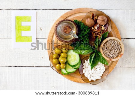 Foods containing vitamin E: walnuts, sunflower seeds, sunflower oil, herbs, pumpkin seeds, olives, cucumbers