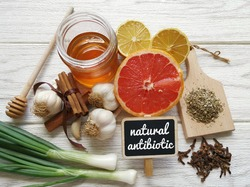 Foods high in antibiotics. Healthy foods with antibacterial properties. Assortment of food protecting against infection. The best natural antibiotic: honey, lemon, garlic, oregano, clove, grapefruit.
