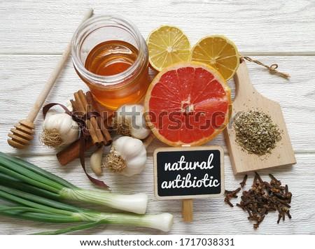 Foods high in antibiotics. Healthy foods with antibacterial properties. Assortment of food protecting against infection. The best natural antibiotic: honey, lemon, garlic, oregano, clove, grapefruit. Photo stock ©