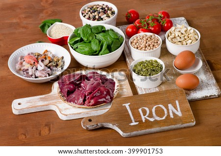 Foods high in Iron, including eggs, nuts, spinach, beans, seafood, liver, sesame, chickpeas, tomatoes.  #399901753