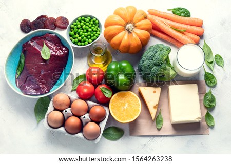 Foods high in vitamin A (Retinol). Protects eyes from blindness;  supports bone health; supports a healthy immune system;  Top view #1564263238