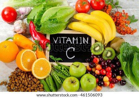 Foods High in vitamin C on a wooden board.  Healthy eating. Top view #461506093