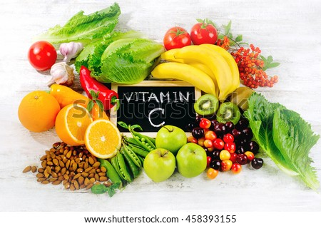 Foods High in vitamin C on wooden board.  Healthy eating. Top view #458393155