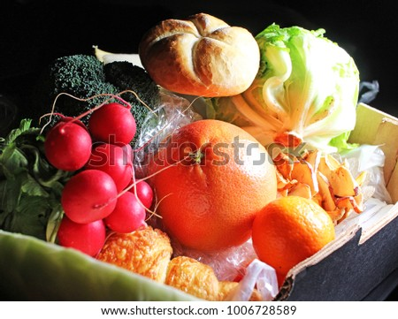 Foods in box ready to home delivery. Fruit vegetable food in box on black reflective studio background. Isolated black shiny mirror mirrored background for every concept.