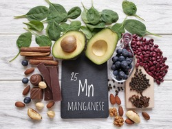 Foods rich in manganese with the chemical symbol Mn for the chemical element manganese. Natural sources of manganese: avocado, cloves, cinnamon, black pepper, spinach, dark chocolate, beans, blueberry