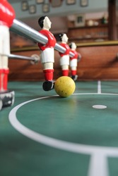 Foosball football in red team colours Soccer Table top stock, photo, photograph, picture, image