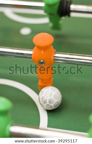 Foosball player with ball