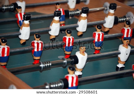 Foosball. Table football. Entertainment playing a miniature soccer