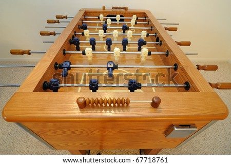 Foosball table in a carpeted room