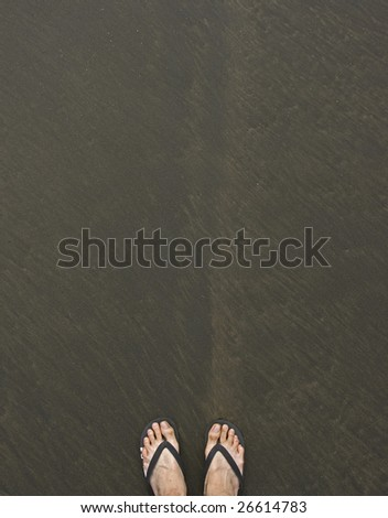 foot and sandals on beach #26614783