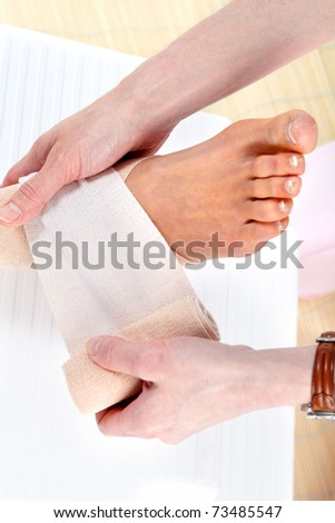 Foot joint pain. Medical bandage. Health care
