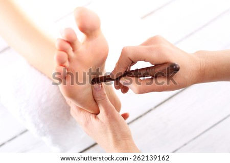 Foot massage, Foot reflexology.Natural medicine, reflexology, acupressure foot massage oppresses energy flow points
