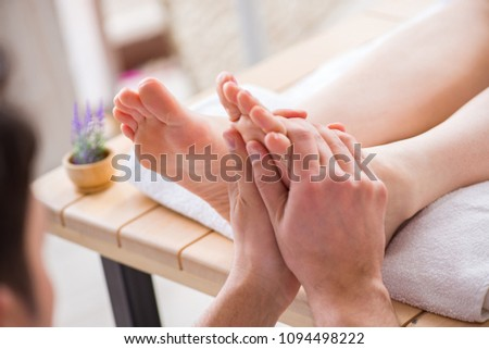 Foot massage in medical spa #1094498222