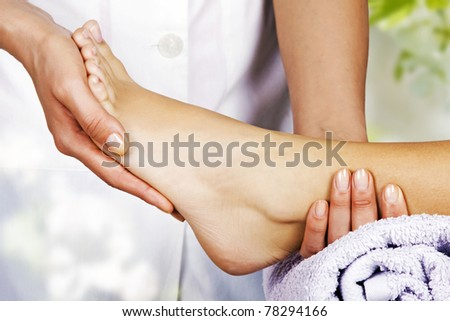 Foot massage in the spa salon in the garden