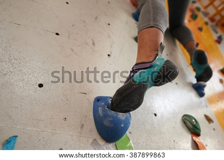 foot of female climber on...