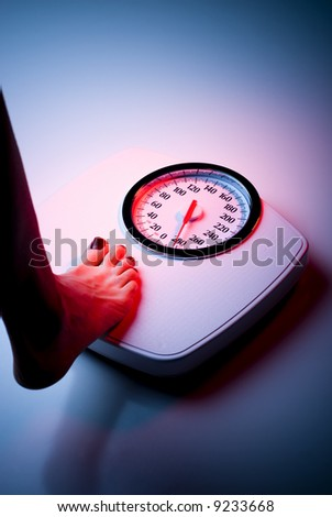 foot on bathroom scale - stock photo