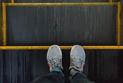 foot on escalator for background & texture