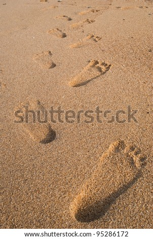 Foot on sand texture background.