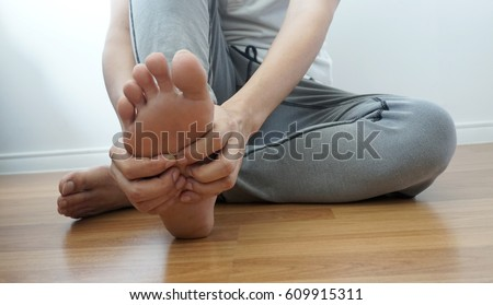Foot pain and foot massage #609915311