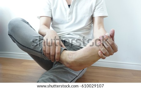 Foot pain and foot massage #610029107