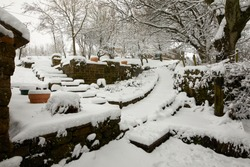 Foot path and entrance covered by deep snow after daylong snowfall on moorland smallholding in Nidderdale.