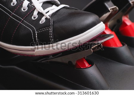 Foot pressing the gas pedal. Close up.