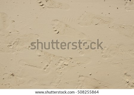 Foot print on sand background.