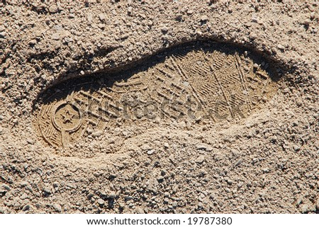 foot print on the sand - stock photo