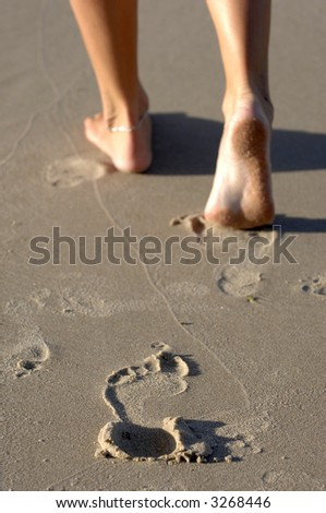 Foot prints in the sand leaving only memories