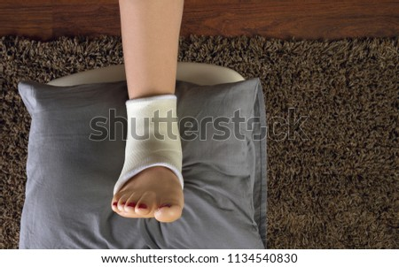 Foot resting on cushion  - Sprained ankle or twisted ankle cast top view #1134540830