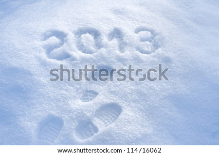 Foot step print in snow, New Year 2013 concept