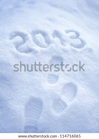 Foot step print in snow,?? New Year 2013 concept