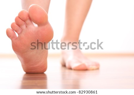 Foot stepping - stock photo