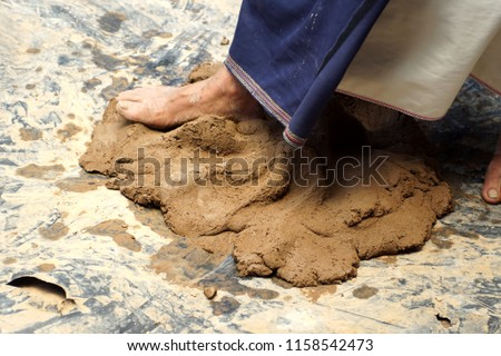 Foot stomping clay to prepare it to be made into pottery in a small village near Cotacachi, Ecuador