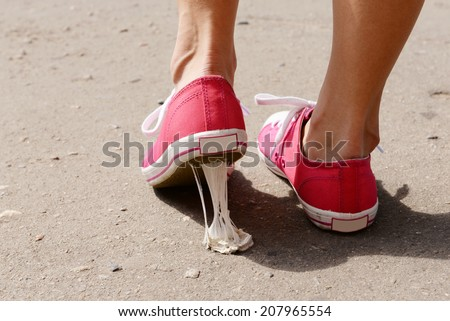 Foot stuck into chewing gum on street Stockfoto ©
