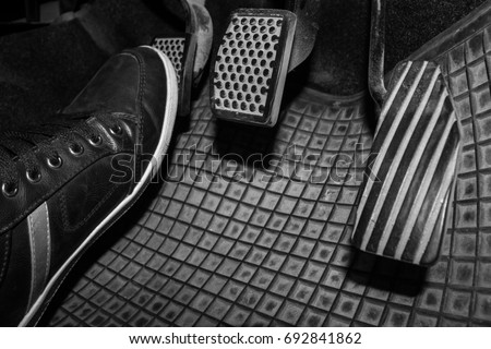 Foot while driving a clutch pedal to control the speed of the drive. #692841862