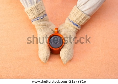 foot with winter cup  in orange bed - stock photo