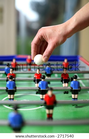 Football about to be dropped to start the game of table football