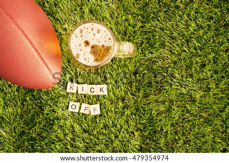 Football and beer jar on grass and Kick Off message
