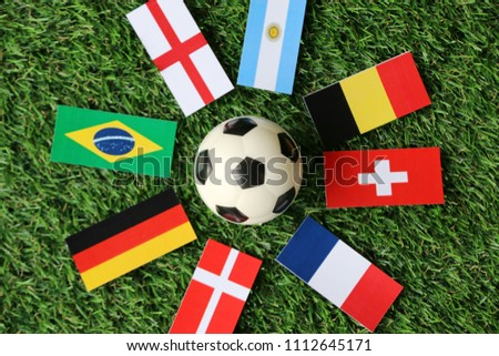 Football and national flags 2018 on Green grass Top view #1112645171