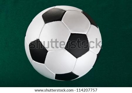 football ball on green background - stock photo