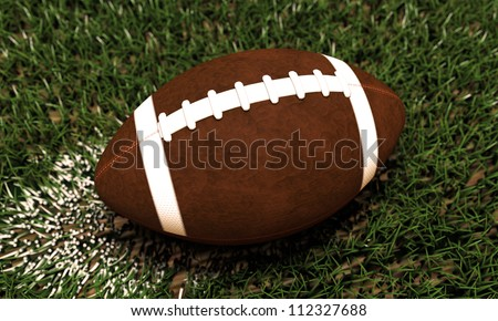 football ball on green grass of a football field - stock photo