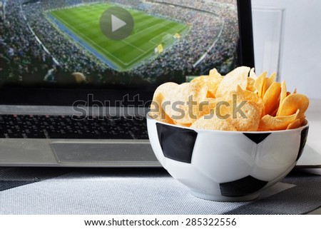 football bowl of chips at a computer with a video broadcast sports fan men, sports, view, home, food