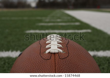 Football close up with room for copy and yardlines carrying off