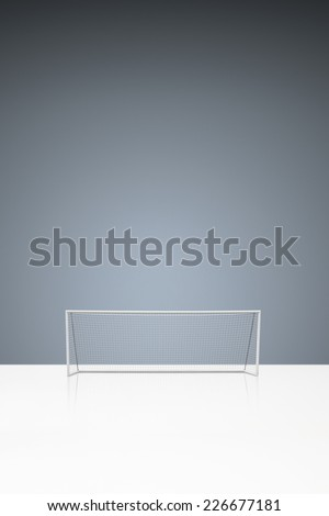 football concept showing empty football goal posts with goal net and space for text